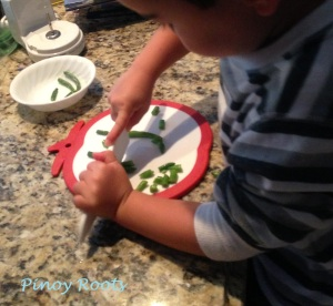 Chopping green beans for pansit