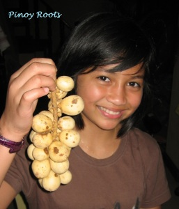 My niece Rai holding lanzones