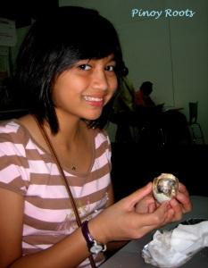 My niece Rai again, this time enjoying balut
